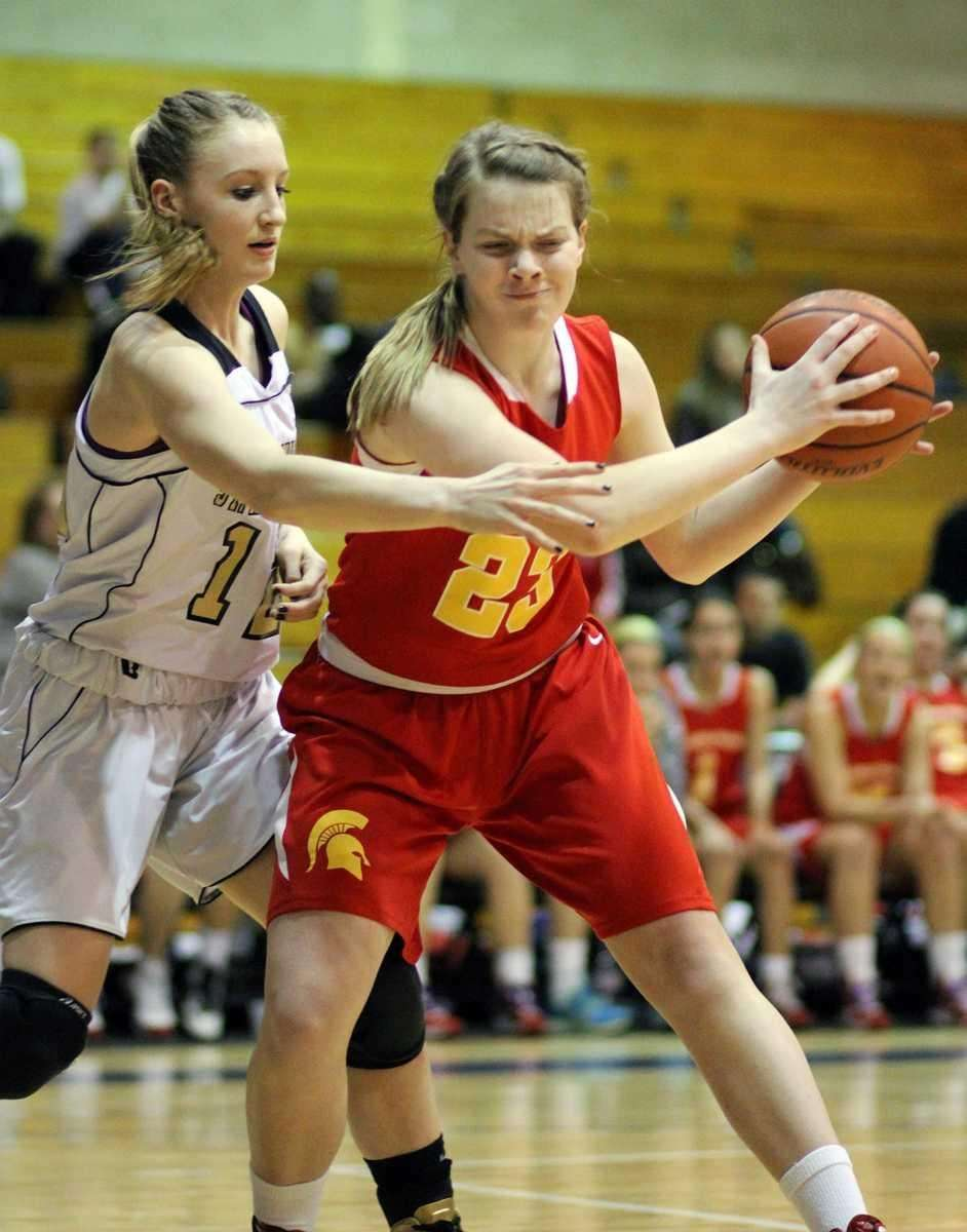 St. Anthony's Rebecca Musgrove plays defense against Sacred