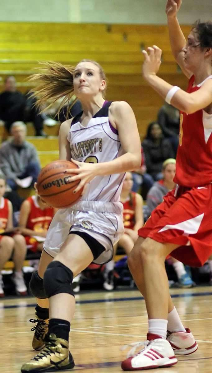 St. Anthony's Rebecca Musgrove drives to the hoop