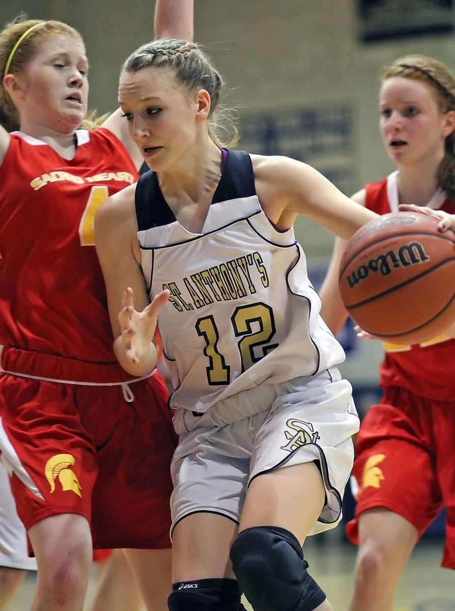 St. Anthony's Rebecca Musgrove drives against Sacred Heart's