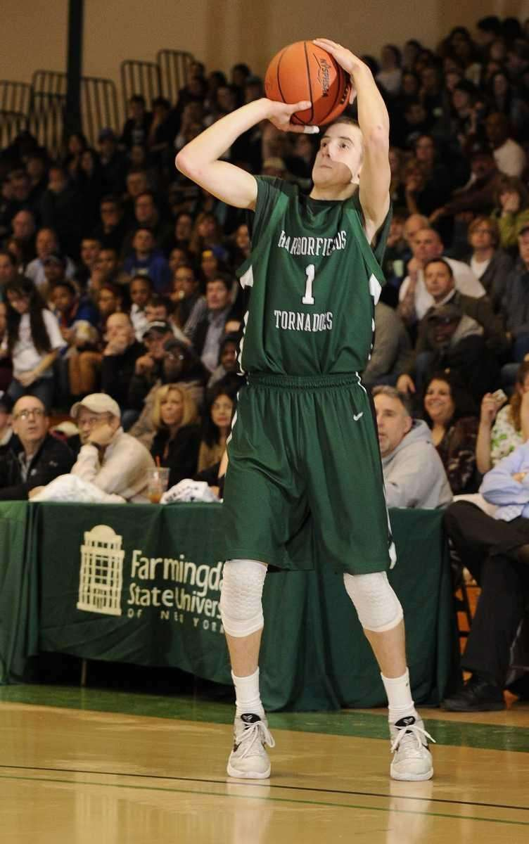 Harborfields guard Lucas Woodhouse shoots a three-pointer against