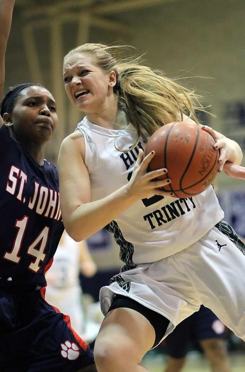 Holy Trinity's Katherine Poppe drives to the basket