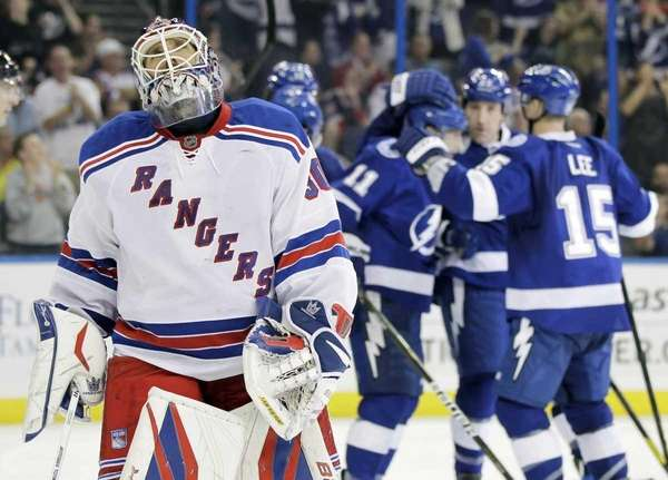 Rangers goalie Henrik Lundqvist reacts as Tampa Bay