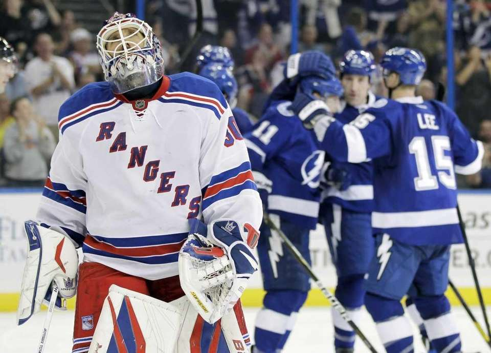 Rangers goalie Henrik Lundqvist reacts as Tampa Bay