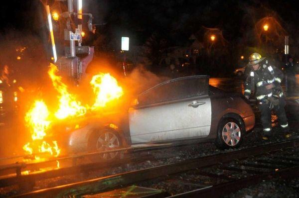 A burning Honda Civic on Long Island Rail