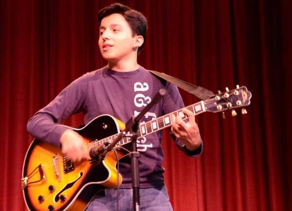 Ninth grader Scott La Marca, 15, strums his
