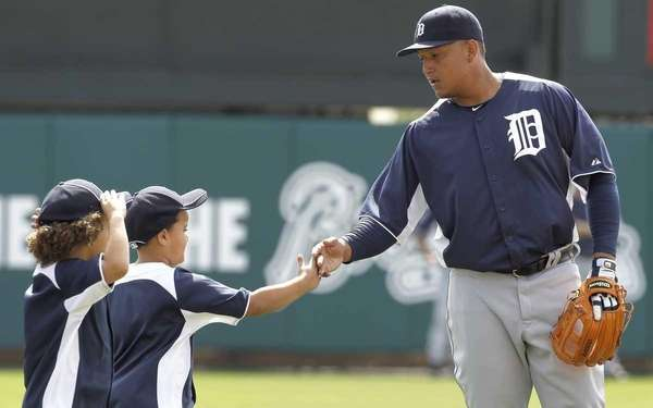 Detroit Tigers third baseman Miguel Cabrera, right, greets