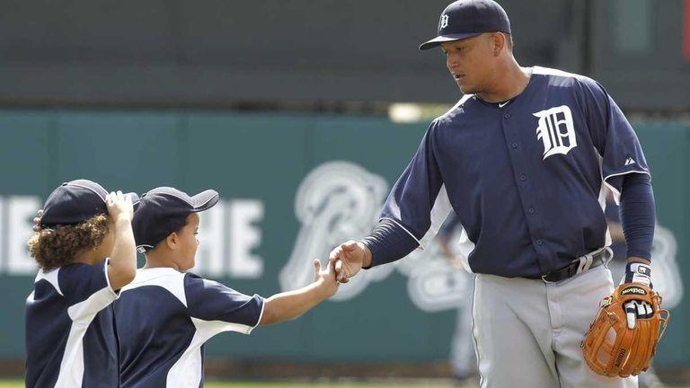 Detroit Tigers third baseman Miguel Cabrera, right, greets