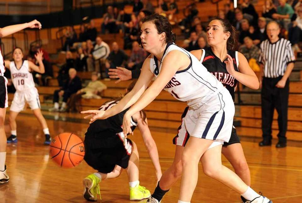 Cold Spring Harbor's #11 Katie Heins bounce passes