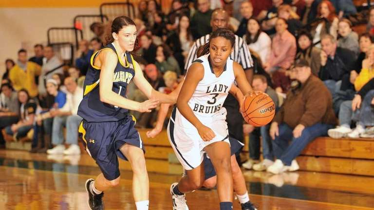 Massapequa's #1 Morgan Roessler, left, guards Baldwin's #3