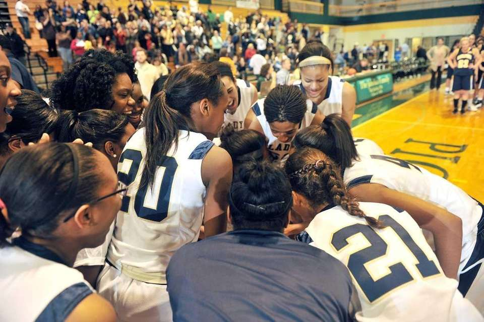 The Baldwin Lady Bruins celebrate after winning the