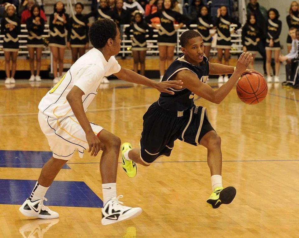 Baldwin point guard Mykeil Tzul drives the ball
