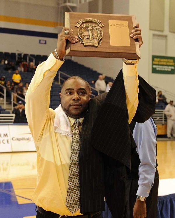Baldwin head coach Darius Burton, Jr. hoists the