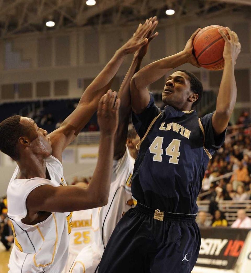 Baldwin center Jordan Williams shoots against Uniondale in
