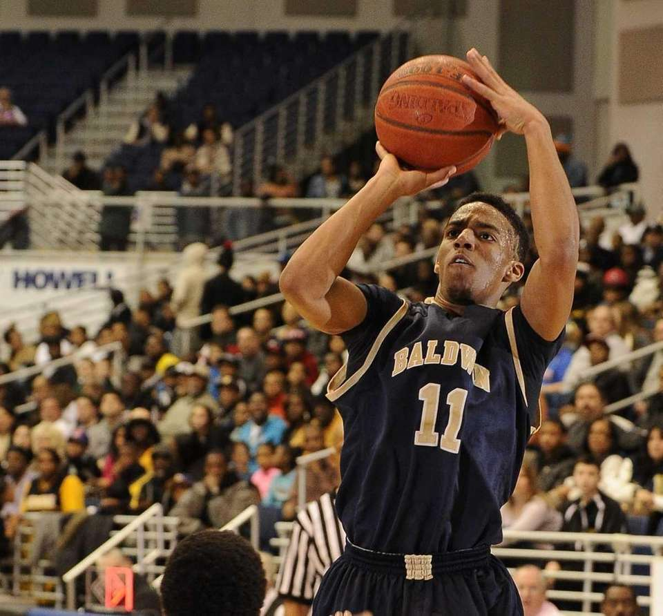 Baldwin point guard Brandon Williams scores on a