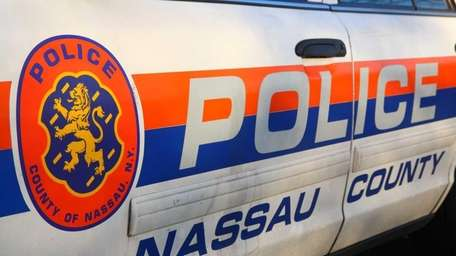 Nassau Police cars outside the fifth precinct on