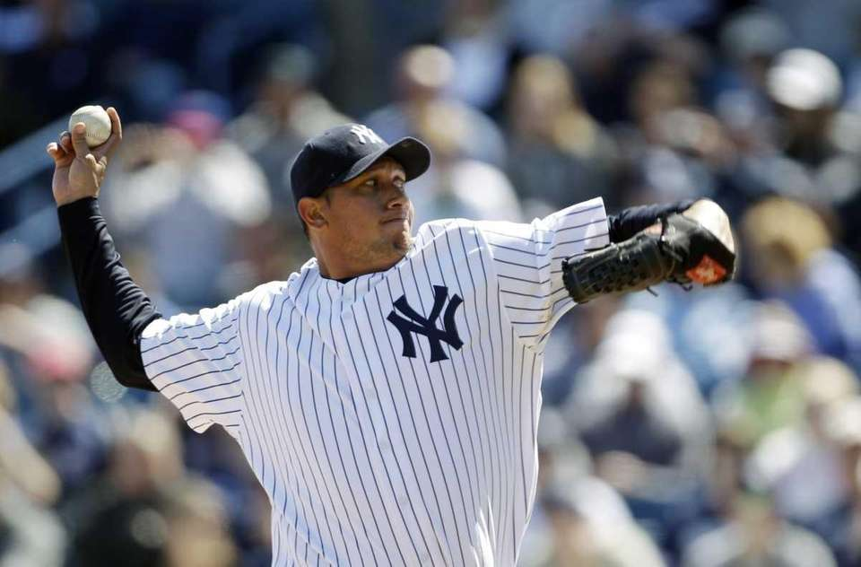 New York Yankees' Freddy Garcia pitches in the