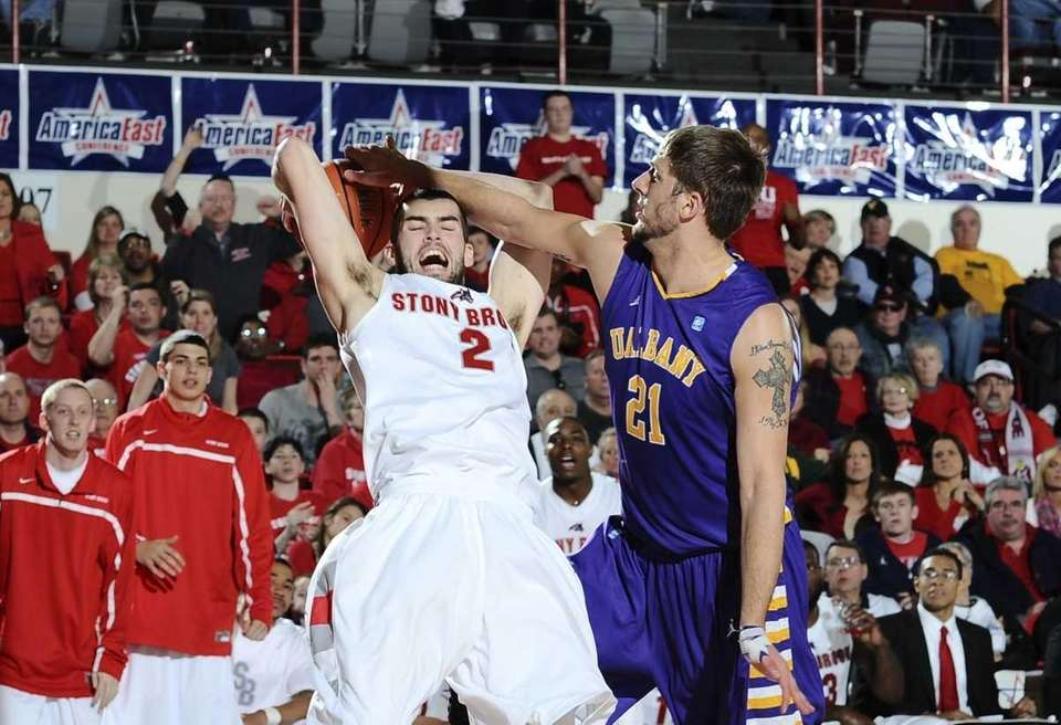Danny Carter is fouled by Albany's Blake Metcalf