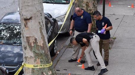 New York City Police investigators work crime scene