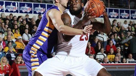 Dallis Joyner drives to the basket defended by