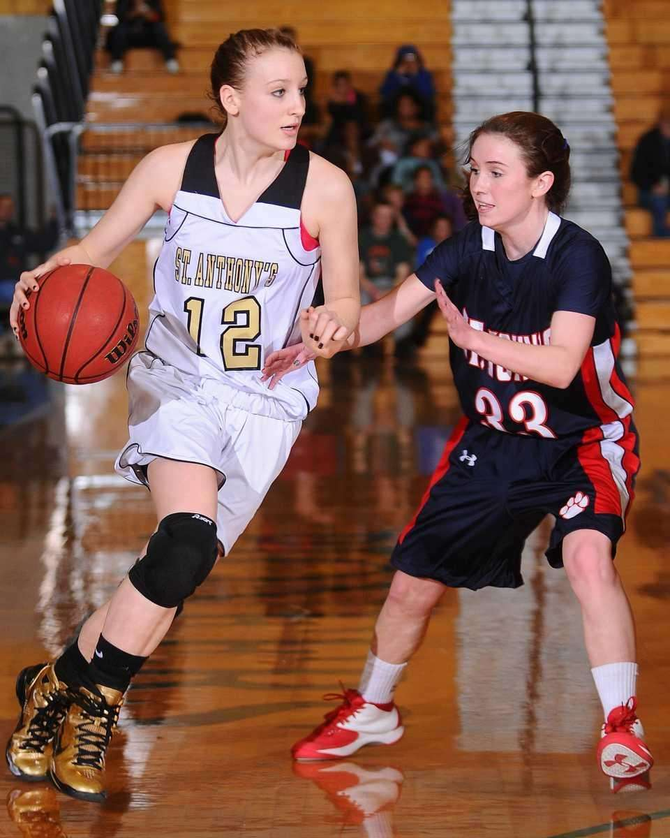 St. Anthony's Rebecca Musgrove, left, looks to get