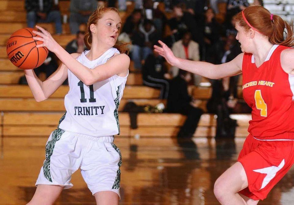 Holy Trinity's #11 Kelly Carey, left, looks to