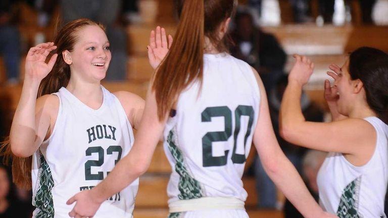 Holy Trinity's #23 Katie Poppe, left, celebrates with