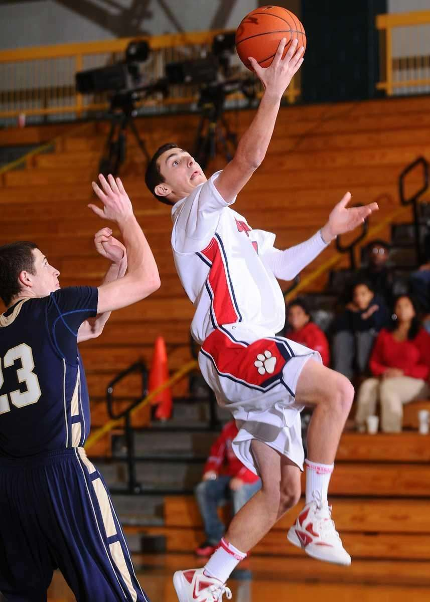 St. John the Baptist's #14 Vincent Yancigay, right,