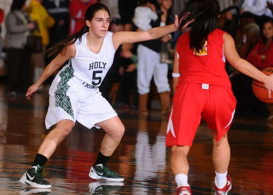 Holy Trinity's #5 Danielle DiGrazia, left, guards Sacred