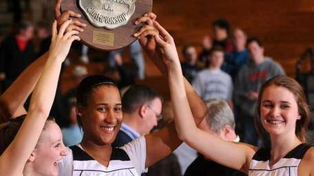 St. Anthony's teammates, from left, #12 Rebecca Musgrove,
