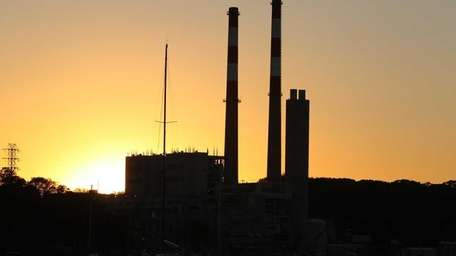 LIPA power plants towers are seen at sunset