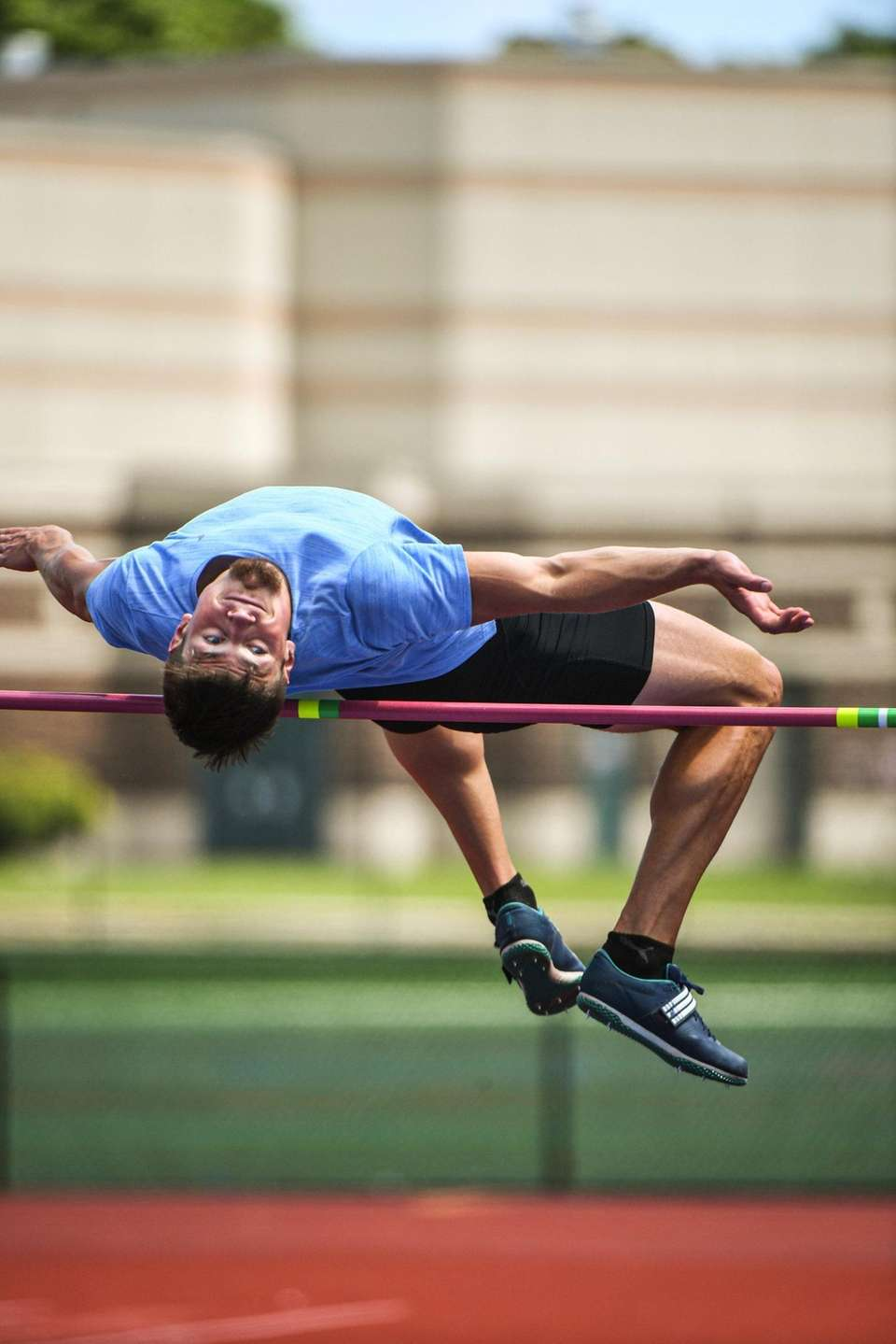 Jack Flood practices the high jump while training