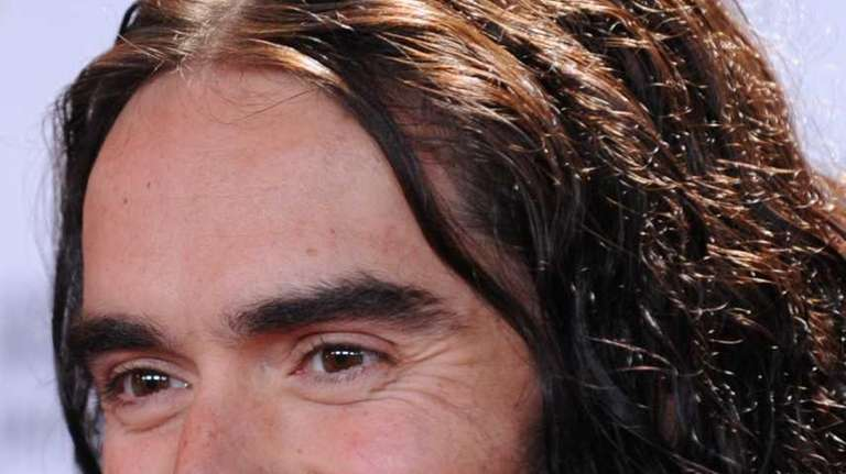 British comedian Russell Brand arrives at Amnesty International's