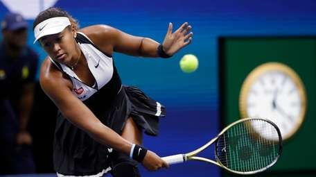 Naomi Osaka returns against Belinda Bencic during the