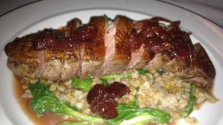Sauteed duck with farro and cherry agrodolce at