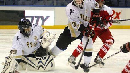 St. Anthony's goalie Daniel Peterson drops for a