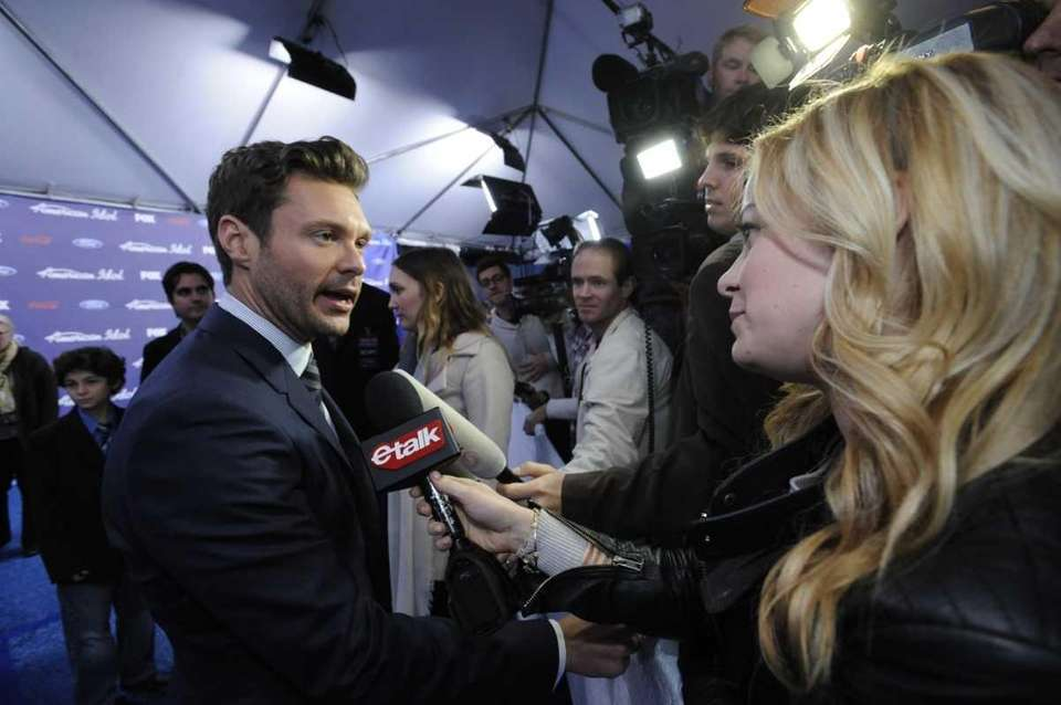 Idol Host Ryan Seacrest arrives on the red