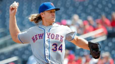Mets starting pitcher Noah Syndergaard delivers to a