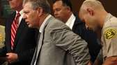 Lenny Dykstra is put in handcuffs after his