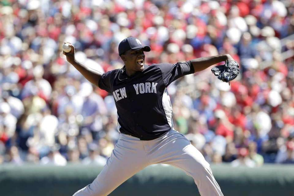 New York Yankees pitcher Michael Pineda throws in
