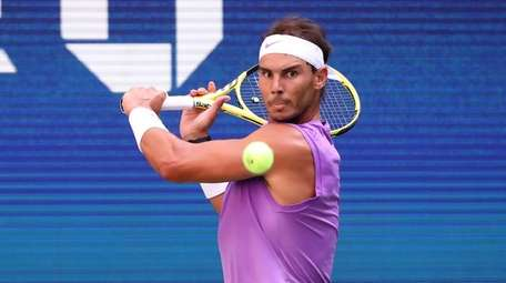 Rafael Nadal with the backhand return against Hyeon