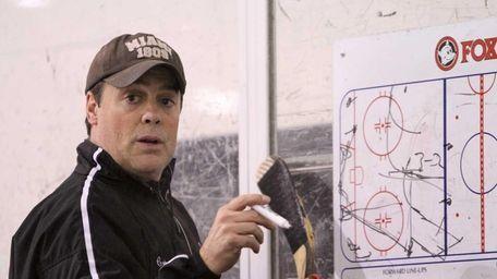 Long Island Royals coach Pat LaFontaine diagrams a