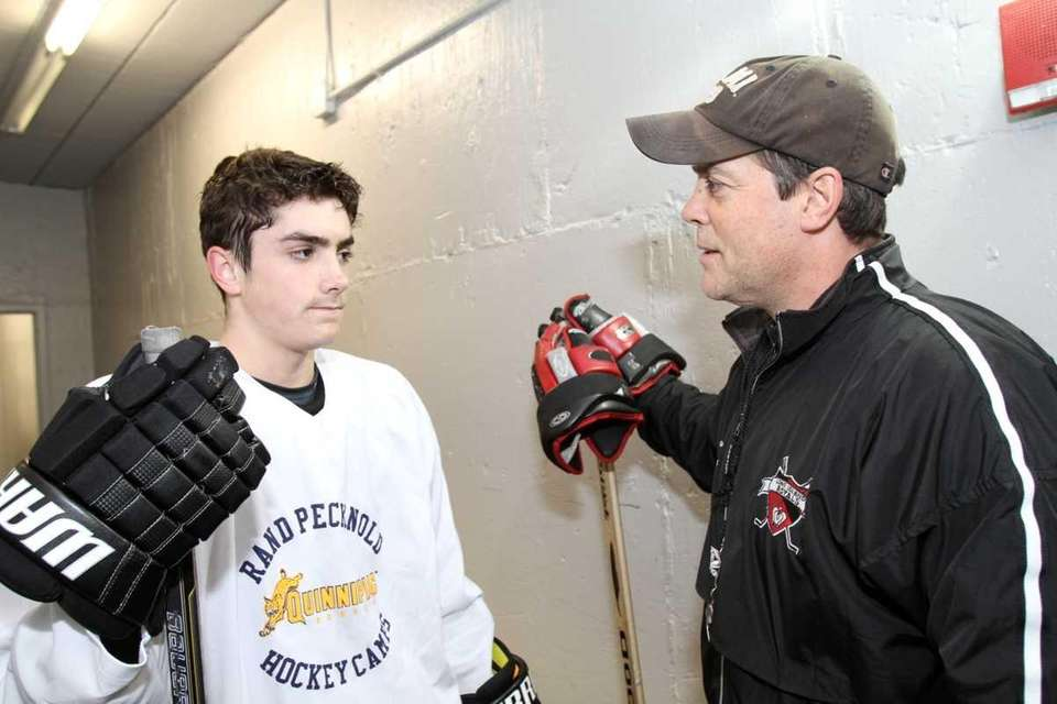 Long Island Royals coach Pat LaFontaine chats with
