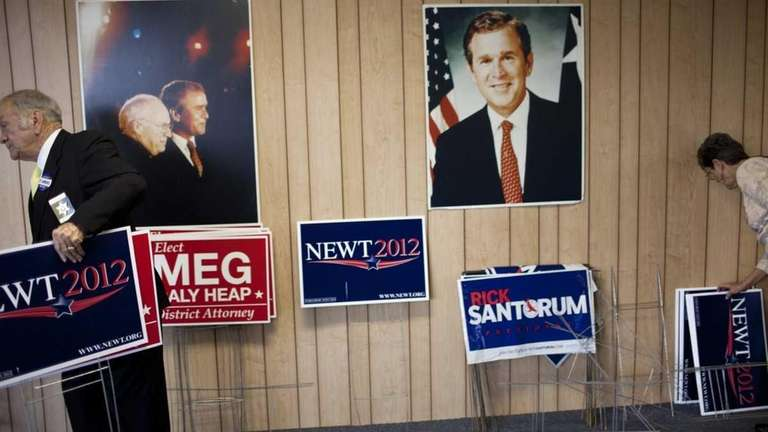 People pick up lawn signs at the Chatham