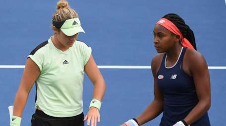 Coco Gauff plays doubles with Catherine McNally against