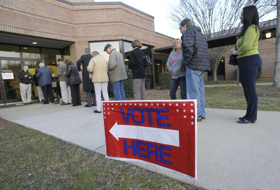 Voters line up to cast their ballots iat