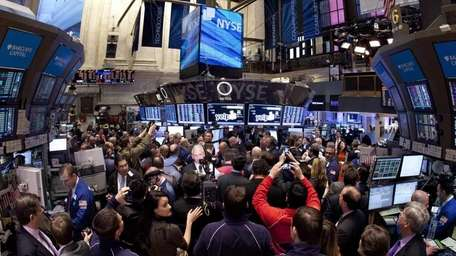 Traders crowd the floor of the New York
