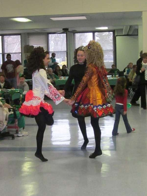 Irish dancers held hands while forming a circle