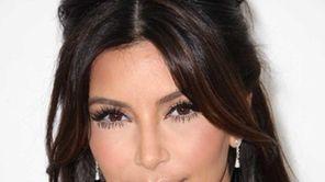 Kim Kardashian arrives at the 20th Annual Elton