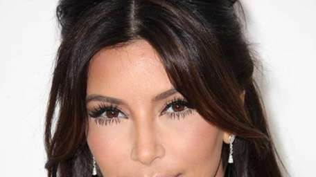 Kim Kardashian arrives at the 20th Annual Elton