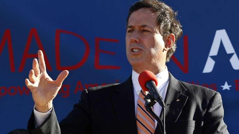 Republican presidential candidate Rick Santorum gestures as he